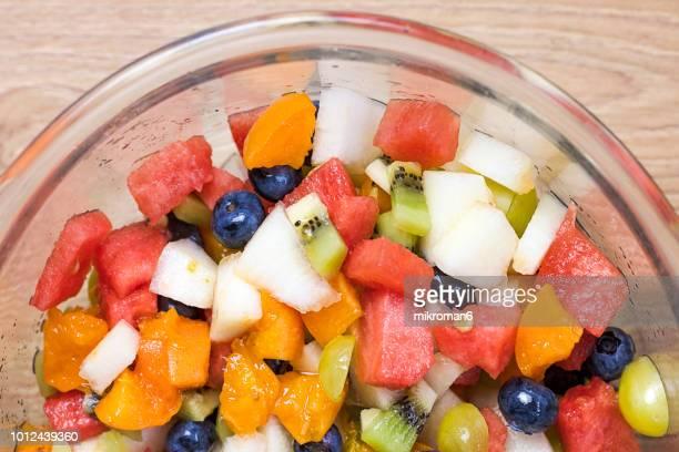 Bowl of fruit salad, close-up. Alkaline diet, food