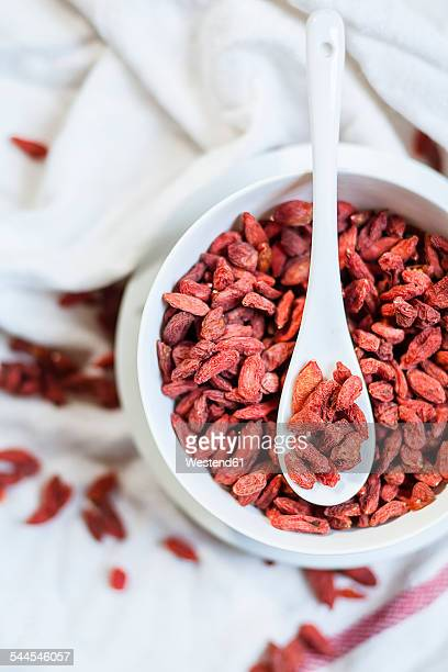 Bowl of Goji berries, Lycium barbarum, on cloth