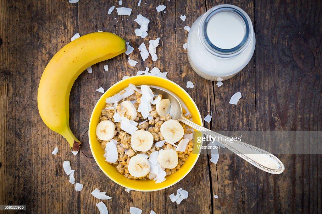 Bowl of granola, banana slices and coconut flakes : Stock Photo