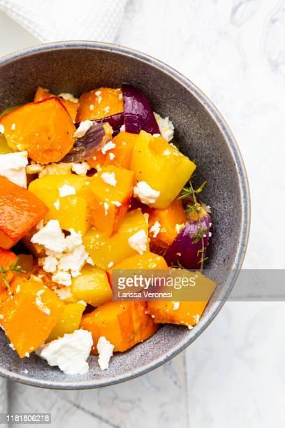 bowl of grilled vegetables with feta cheese - larissa veronesi stock-fotos und bilder