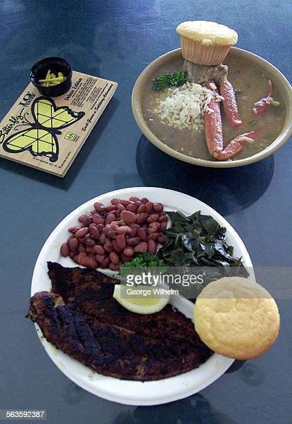 8/24/2001 – A bowl of gumbo with red beans and rice and a plate of blackened catfish with red beans and greens at SeaPreme Restaurant a...