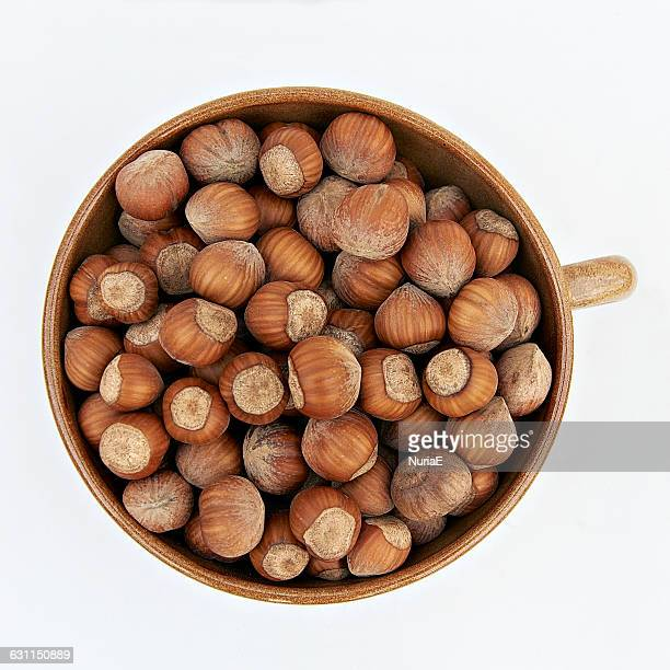 bowl of hazelnuts - hazelnuts stock pictures, royalty-free photos & images