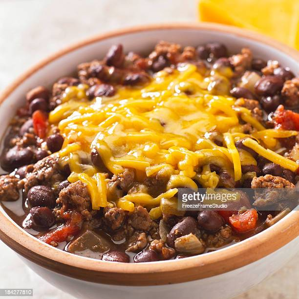 Bowl of homemade bean chili with melted cheese