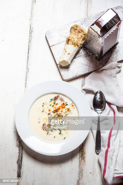 Bowl of horseradish soup with Tafelspitz, potatoes, carrots and chives