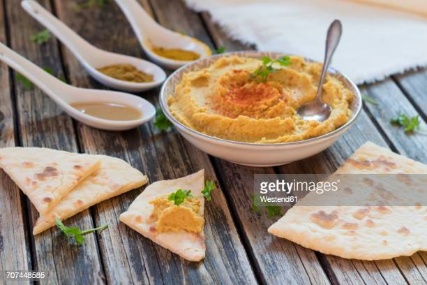 bowl of hummus and flat bread on wood - flat leaf parsley stock pictures, royalty-free photos & images