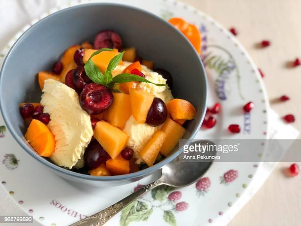 Bowl of ice cream with fruits ready to eat