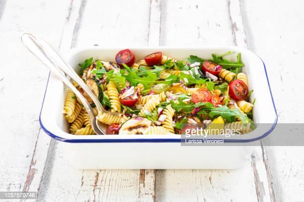 bowl of italian pasta salad - larissa veronesi stock-fotos und bilder