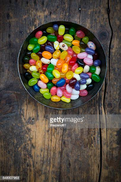 bowl of jelly beans - bowl of candy stock photos and pictures