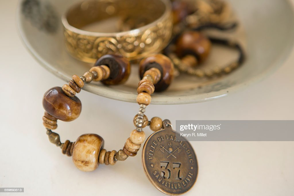 Bowl of jewelry : Stock Photo