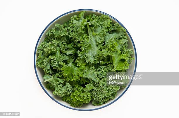 bowl of kale - kale stock photos and pictures