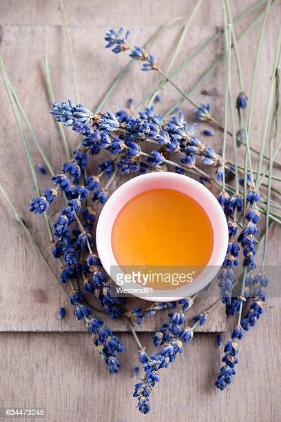 Bowl of lavender honey and lavender blossoms
