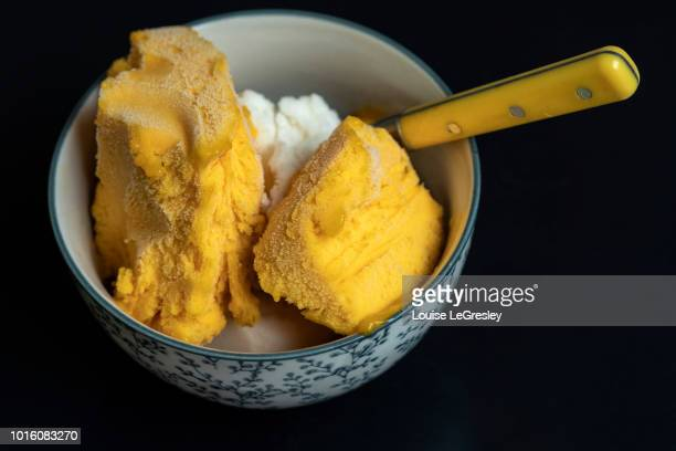 a bowl of mango flavored sorbet - sorbet stock pictures, royalty-free photos & images