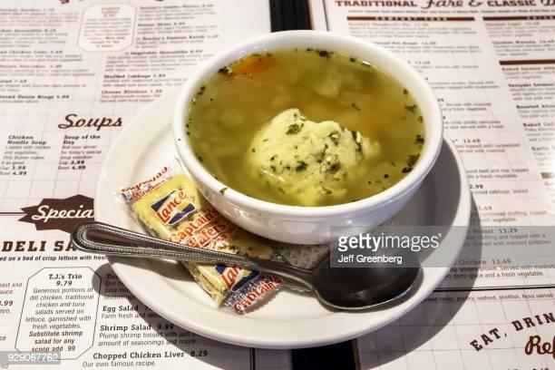A bowl of matzo matza ball soup from Toojay's Original Gourmet Deli