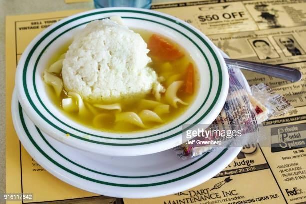 A bowl of matzo matzot ball soup from Bagel Bar East