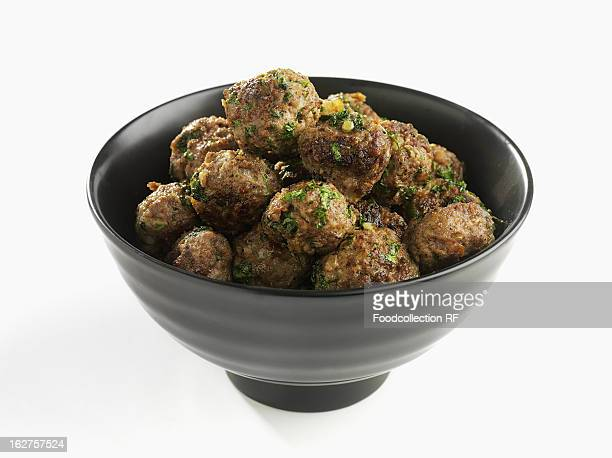 Bowl of meatballs with herbs