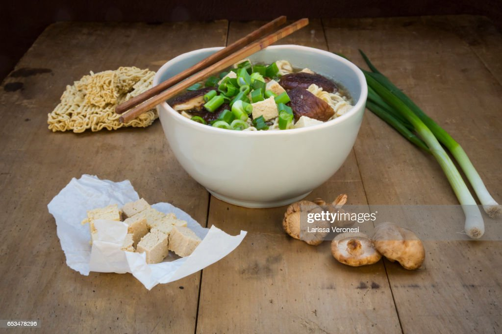 Bowl of miso ramen soup with organic tofu, shitake mushrooms and spring onions on dark wood : Stock-Foto