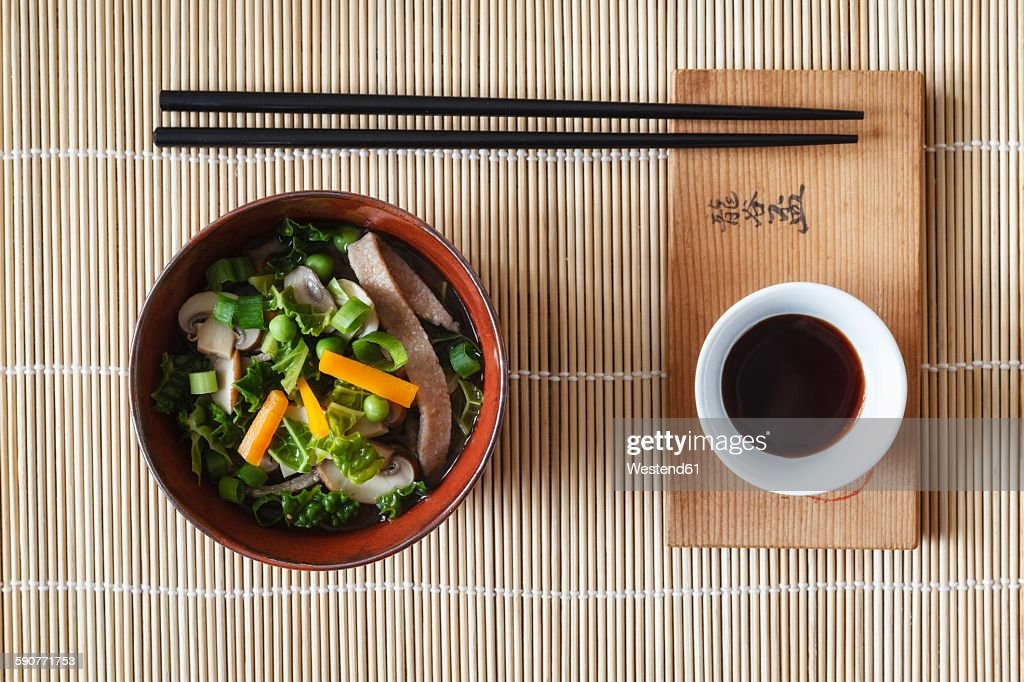 Bowl of miso soup with carrots, champignons and savoy : Stock Photo