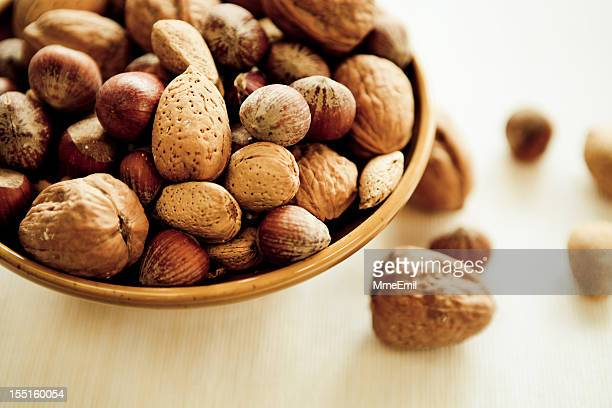 A bowl of mixed nuts still in their shell