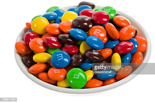 bowl of m&m's. - bowl of candy stock photos and pictures