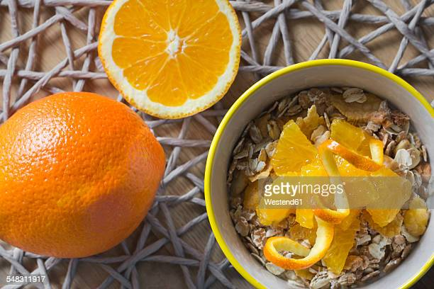 Bowl of muesli with slices of orange