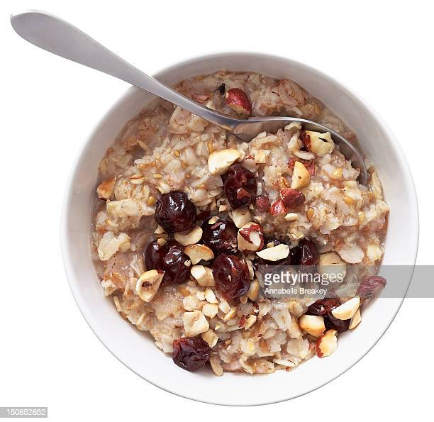 bowl of oatmeal with nuts and berries - oatmeal stock photos and pictures