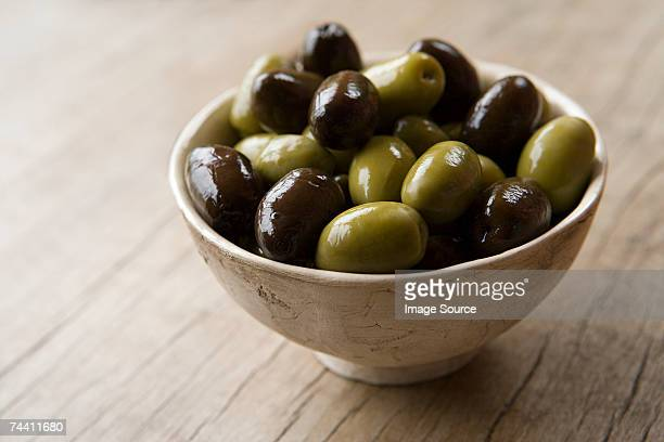 bowl of olives - green olive stock photos and pictures