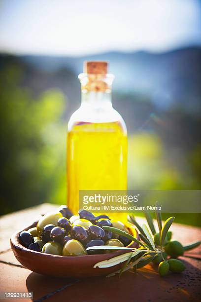Bowl of olives with olive oil