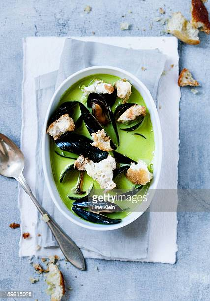 Bowl of pea and mussels soup