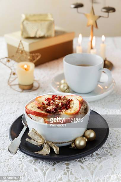 Bowl of porridge with roasted apple at Christmas time