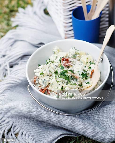 Bowl of potato salad with bacon