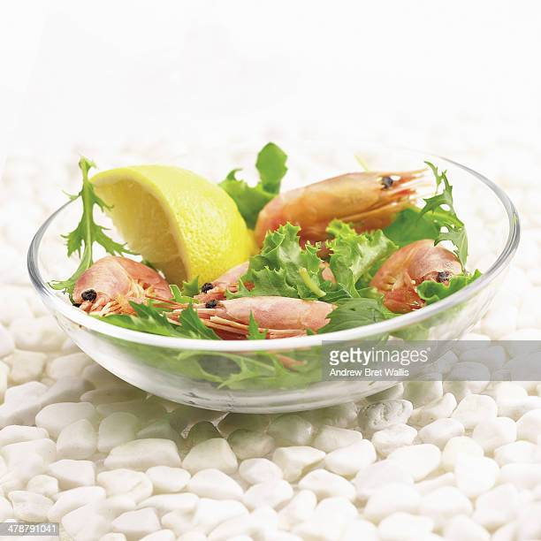 Bowl of prawns with lemon and lettuce