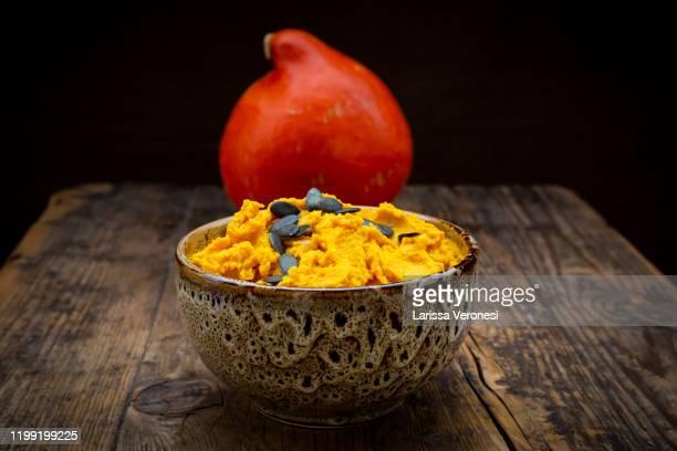 bowl of pumpkin hummus - larissa veronesi fotografías e imágenes de stock