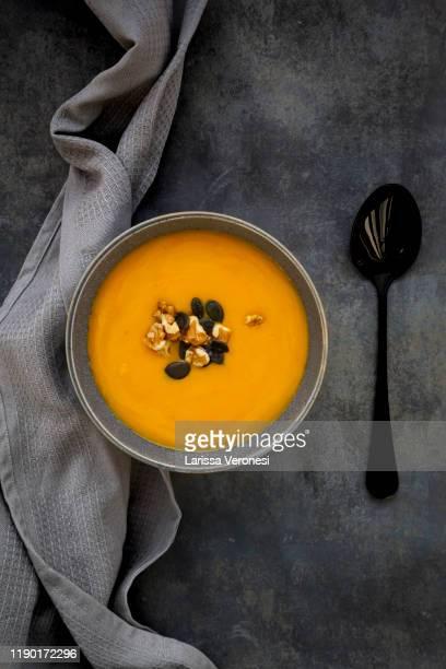 bowl of pumpkin sweet potato soup - larissa veronesi stock-fotos und bilder