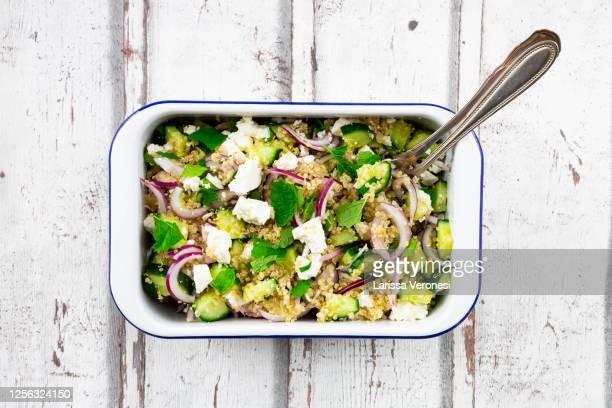 bowl of quinoa salad - larissa veronesi stock-fotos und bilder