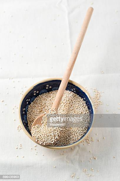 Bowl of quinoa with wooden spoon