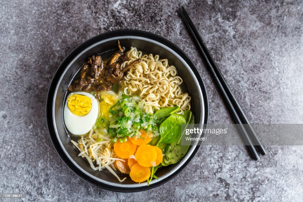 Bowl of ramen soup with spinach, carrot, boiled egg, bamboo sprouts and mushrooms : Stock Photo