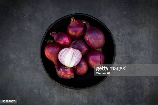bowl of red onions - vignette stock photos and pictures