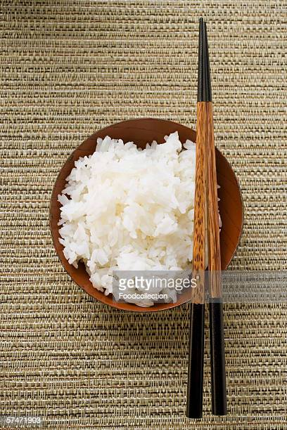 bowl of rice and chopsticks - boiled stock pictures, royalty-free photos & images