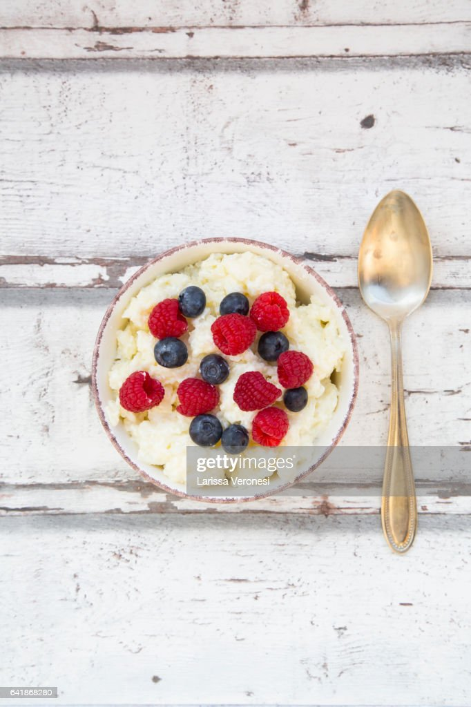 Bowl of Rice Pudding with Berries : Stock Photo