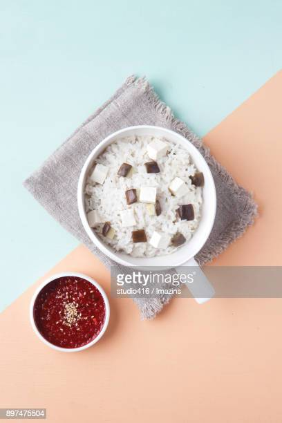a bowl of rice topped with cubical eggplants and sauce - korean food stock pictures, royalty-free photos & images