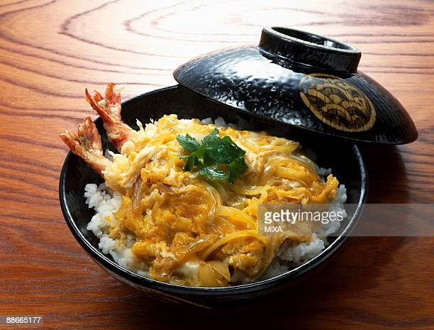 bowl of rice topped with tempura and egg soup - tendon stock photos and pictures