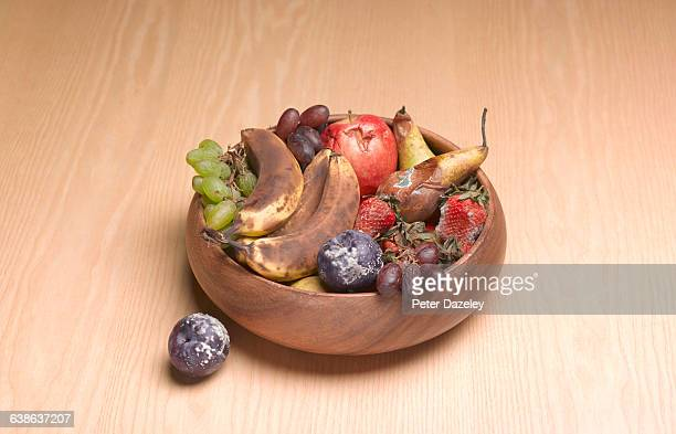 Bowl of rotting fruit on table
