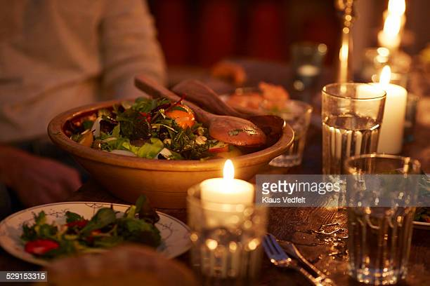 Bowl of rustic organic salad at candlelight dinner