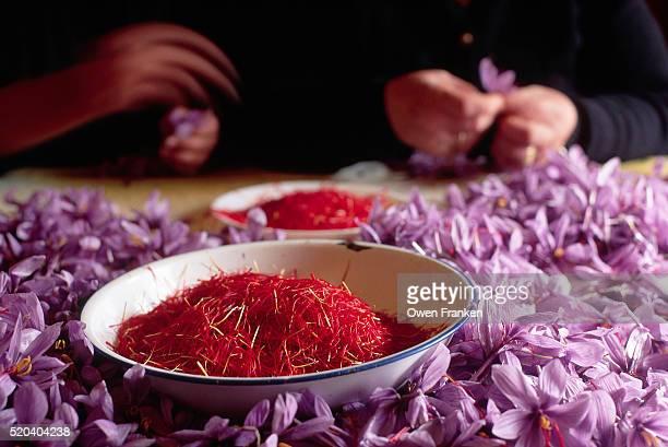 Bowl of Saffron Amid Table of Crocus Blossoms