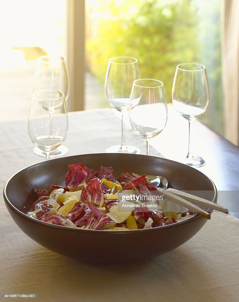 Bowl of salad and empty wine glasses : Stock Photo