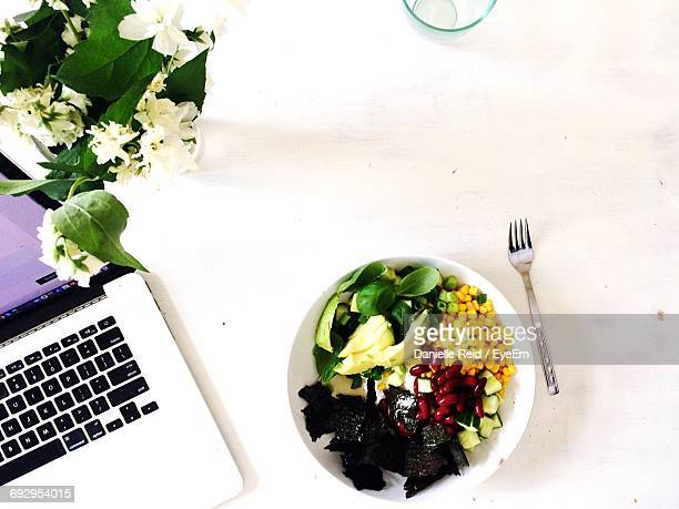 Bowl Of Salad By Laptop On Table