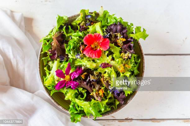 bowl of salad with edible flowers