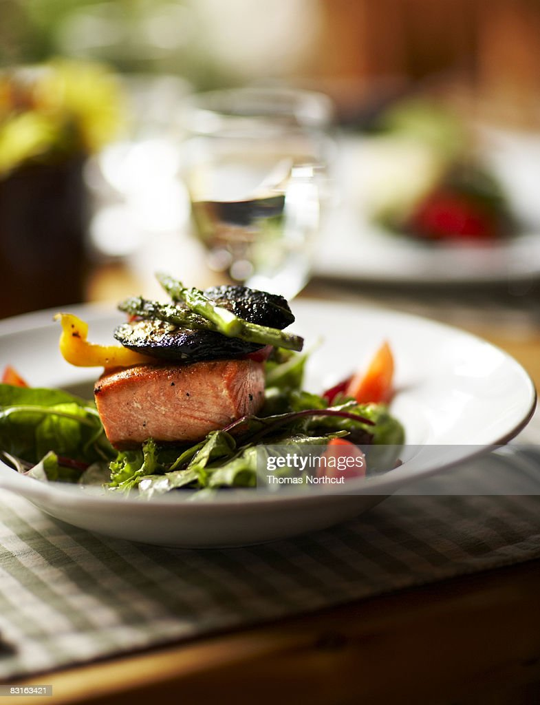 Bowl of salad with salmon and roasted vegetables : Stock Photo