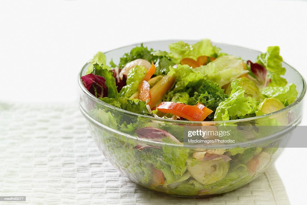 Bowl of salad with shrimp and vegetables sitting on a paper towel, close-up, part of : Stock Photo