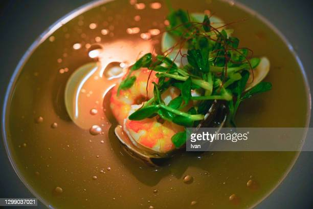 bowl of seafood soup and clam - tikka masala stock pictures, royalty-free photos & images